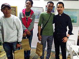 Fr Pablo Velasques with seafarers and their Christmas gift bags