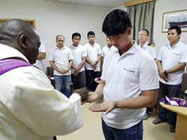 Fr Bongani, AoS port chaplain in Richards Bay South Africa distributes ash