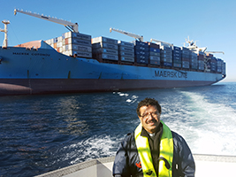 AoS Cape Town port chaplain Fr Gerardo Garcia meets crew members on their ship